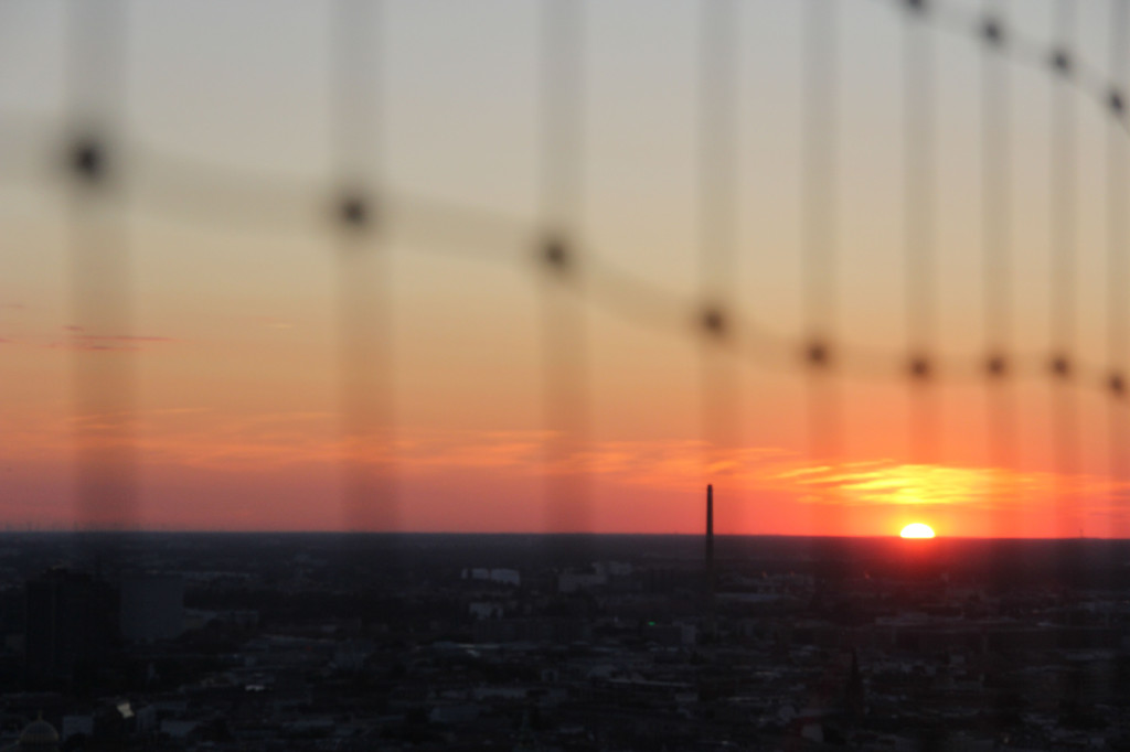 Sunset through netting: The view from the Sun Terrace of the Park Inn on Alexanderplatz