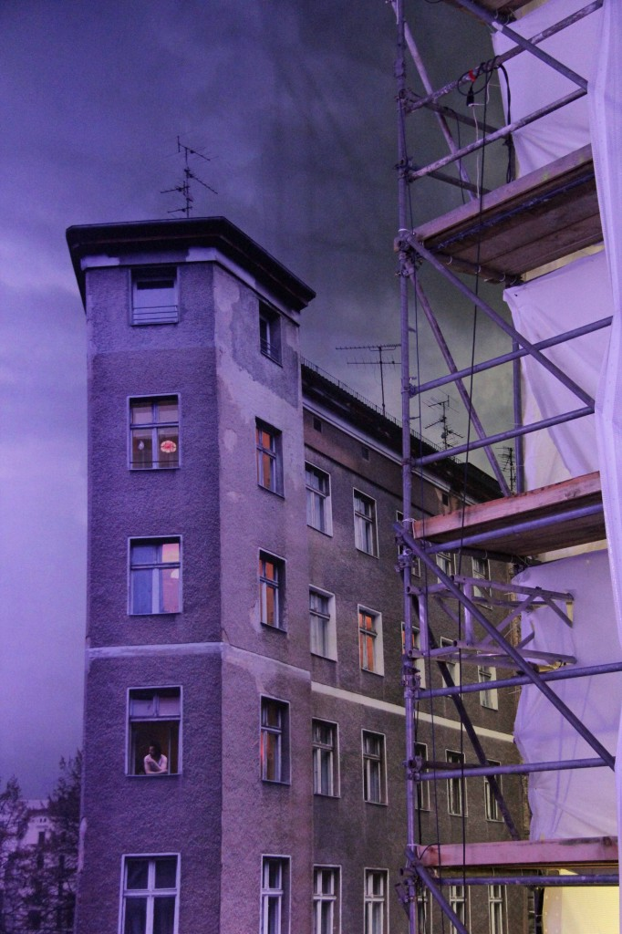 A Plattenbau and scaffold in the Asisi Panorama: Die Mauer (The Wall) and exhibit near Checkpoint Charlie in Berlin