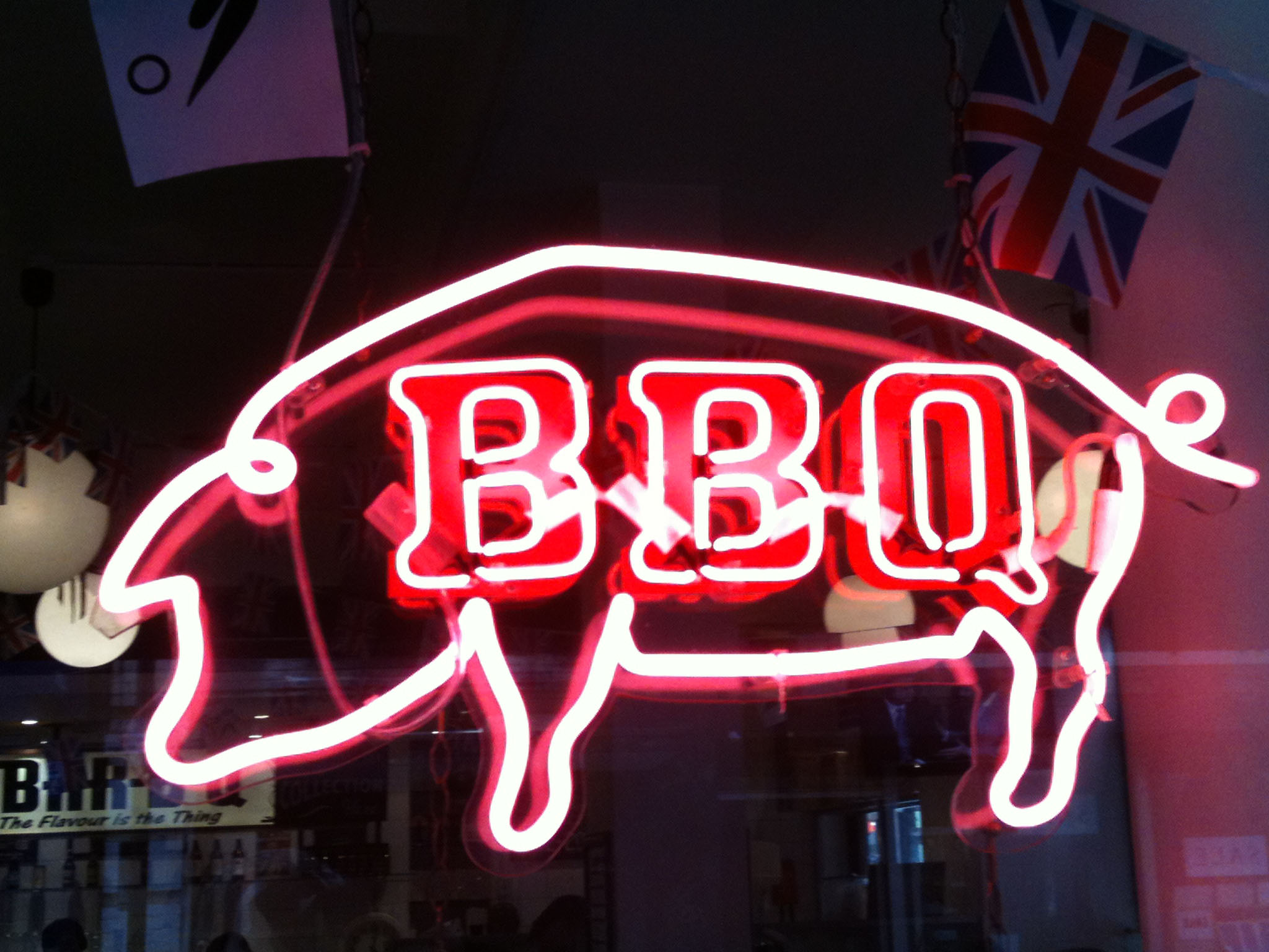 BBQ Pig - A neon sign in the window at Bodean's BBQ in Soho, London