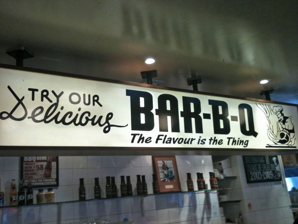 The Flavour is the Thing - The sign behind the counter at Bodean's BBQ in Soho, London