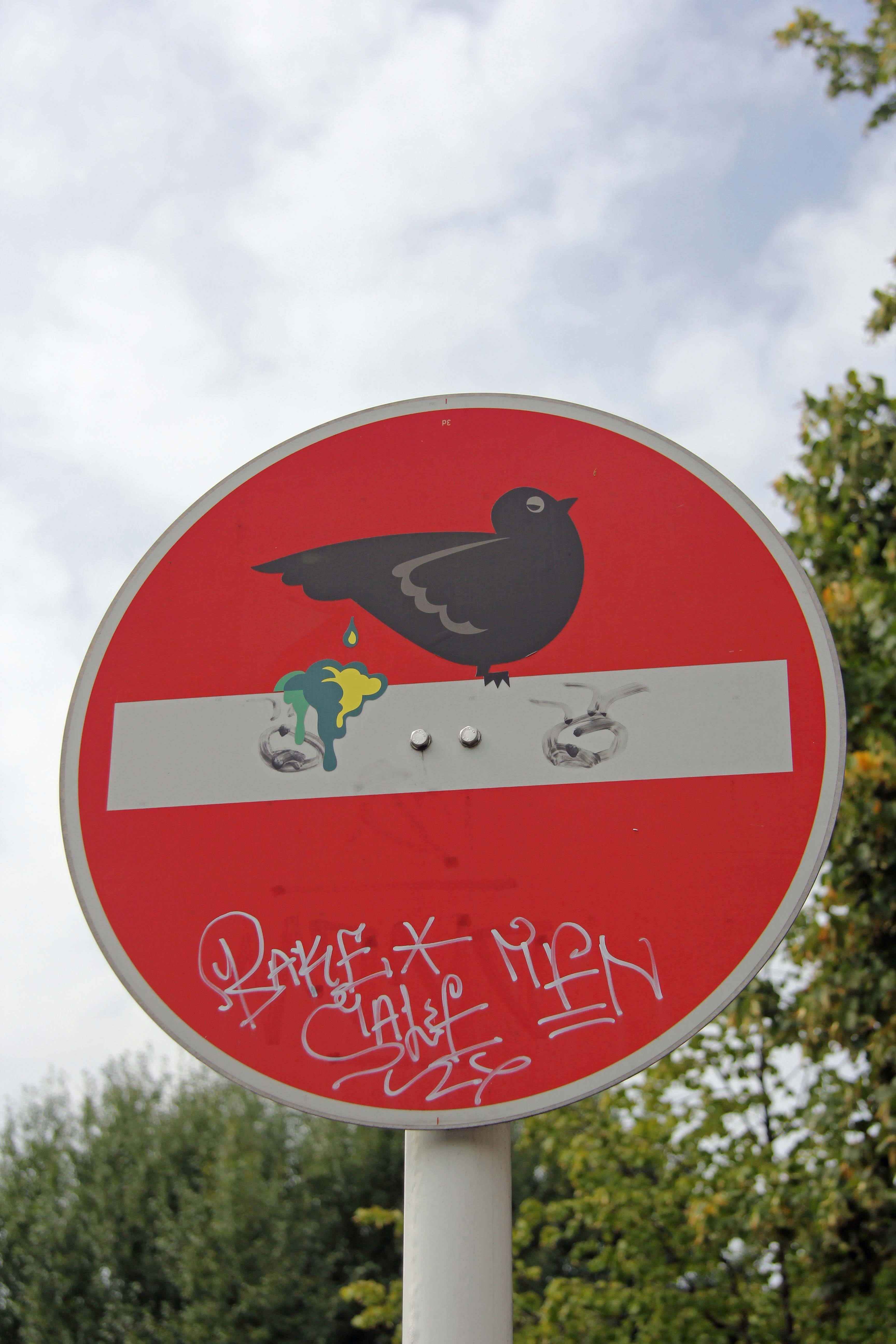 Bird Shitting On Perch: A modified street sign - Street Art by CLET in Berlin