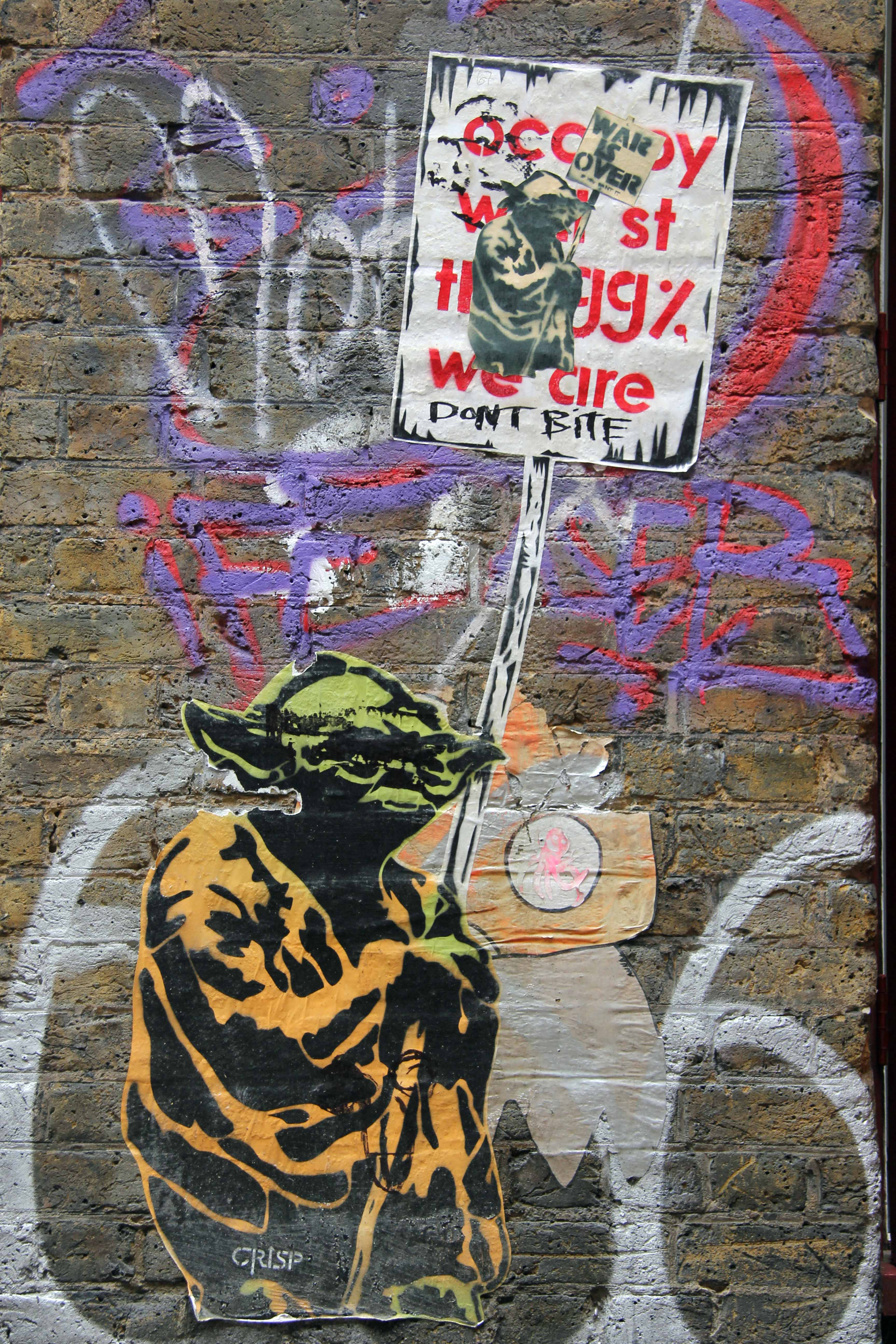 Yoda Protesting for the Occupy movement - Street Art by CRISP in East London