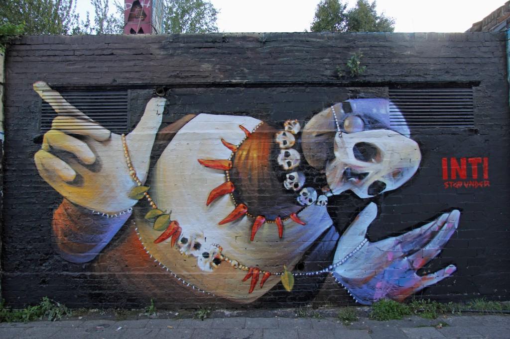 Skulls at YAAM: Street Art by INTI in Berlin