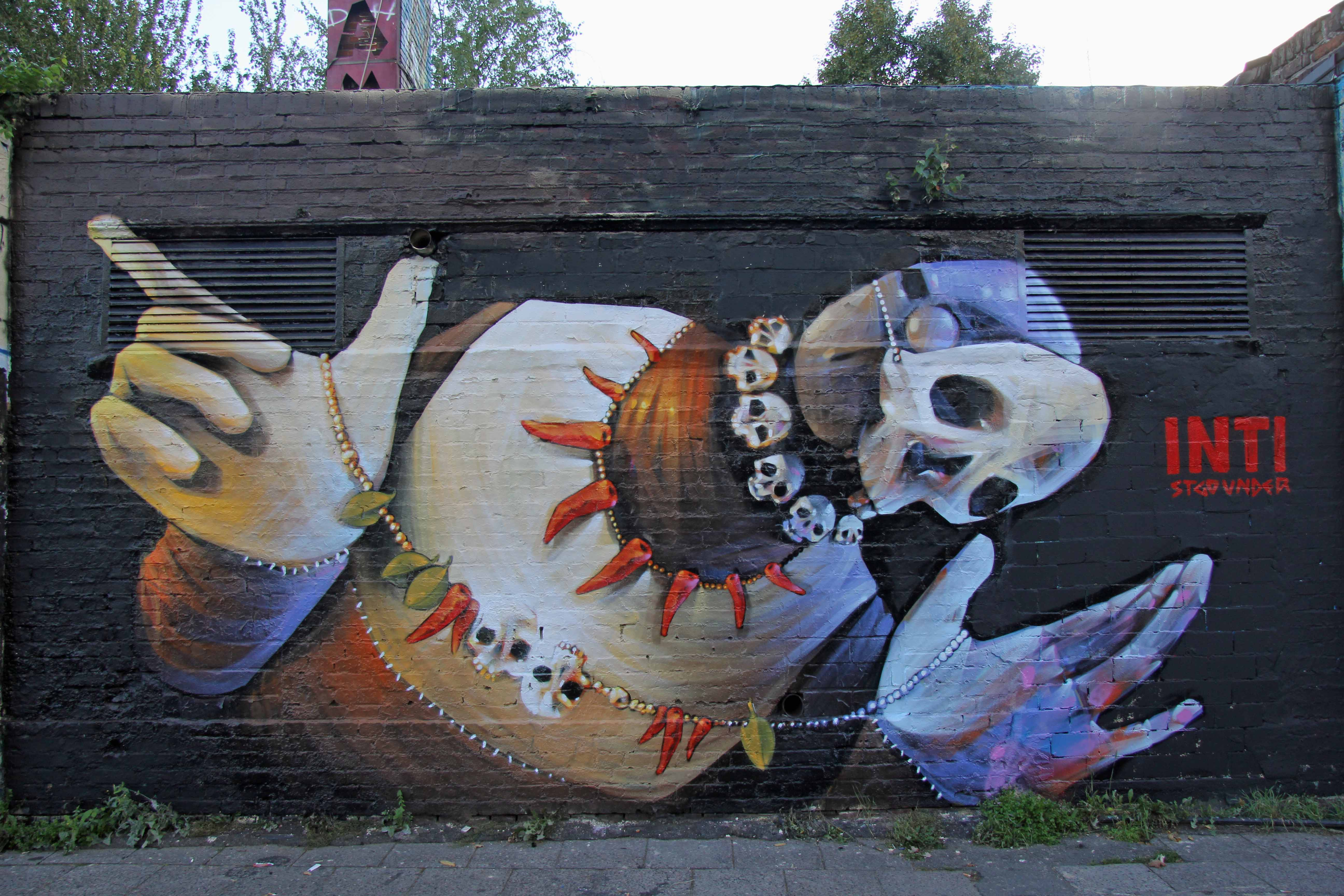 Skulls at YAAM: Street Art by INTI in Berlin