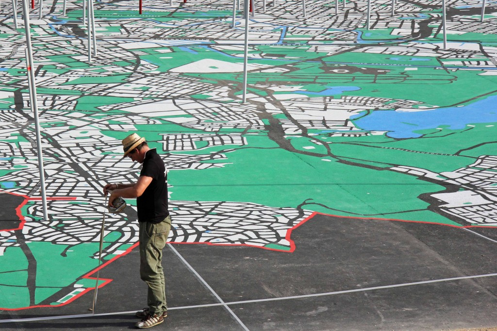 An artist at work on the map on the Schlossplatz, the City of Diversity Exhibit part of Berlin's 775th Anniversary celebrations