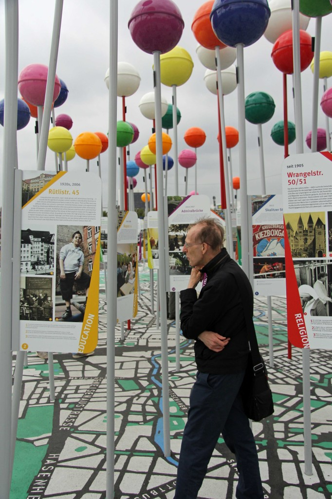A visitor walks through the pins on the map on the Schlossplatz, the City of Diversity Exhibit part of Berlin's 775th Anniversary celebrations