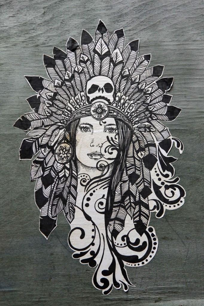 Feathered Headdress: Street Art by Unknown Artist in Berlin