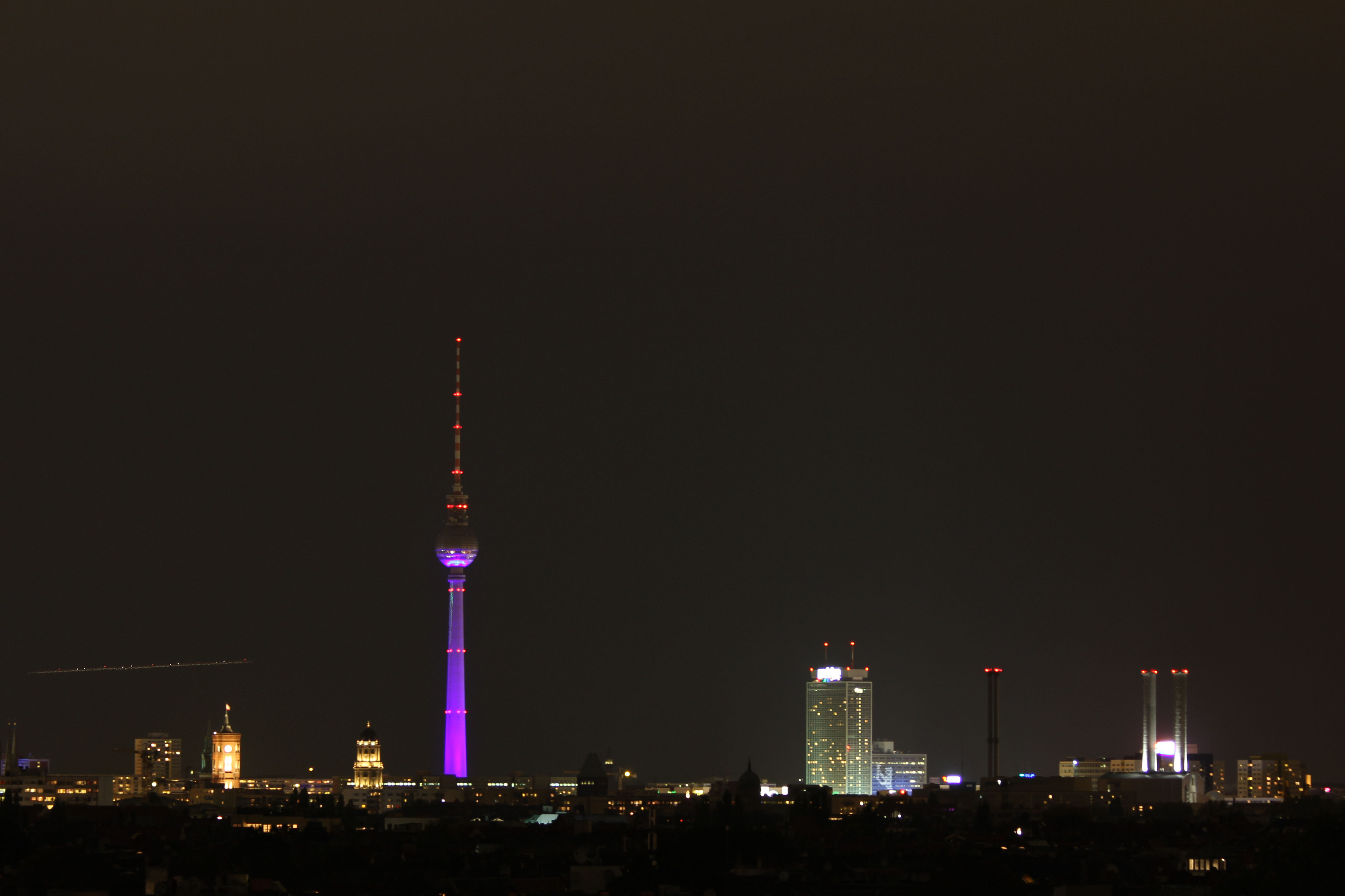 The Berlin skyline at night from the roof of the parking garage of the Neukölln Arcaden