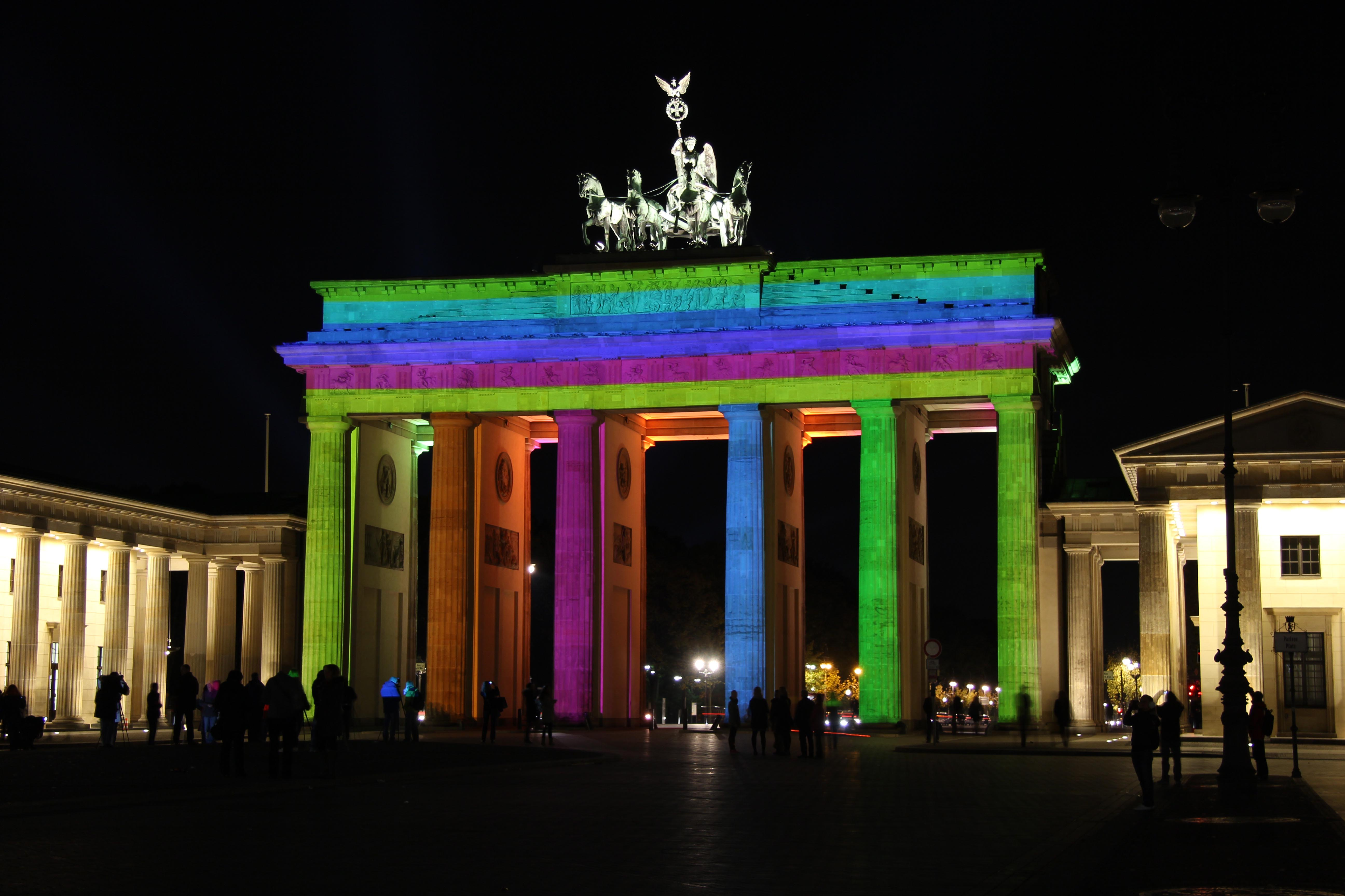 Brandenburger Tor (The Brandenburg Gate) lit up in many colours during the Festival of Lights in Berlin