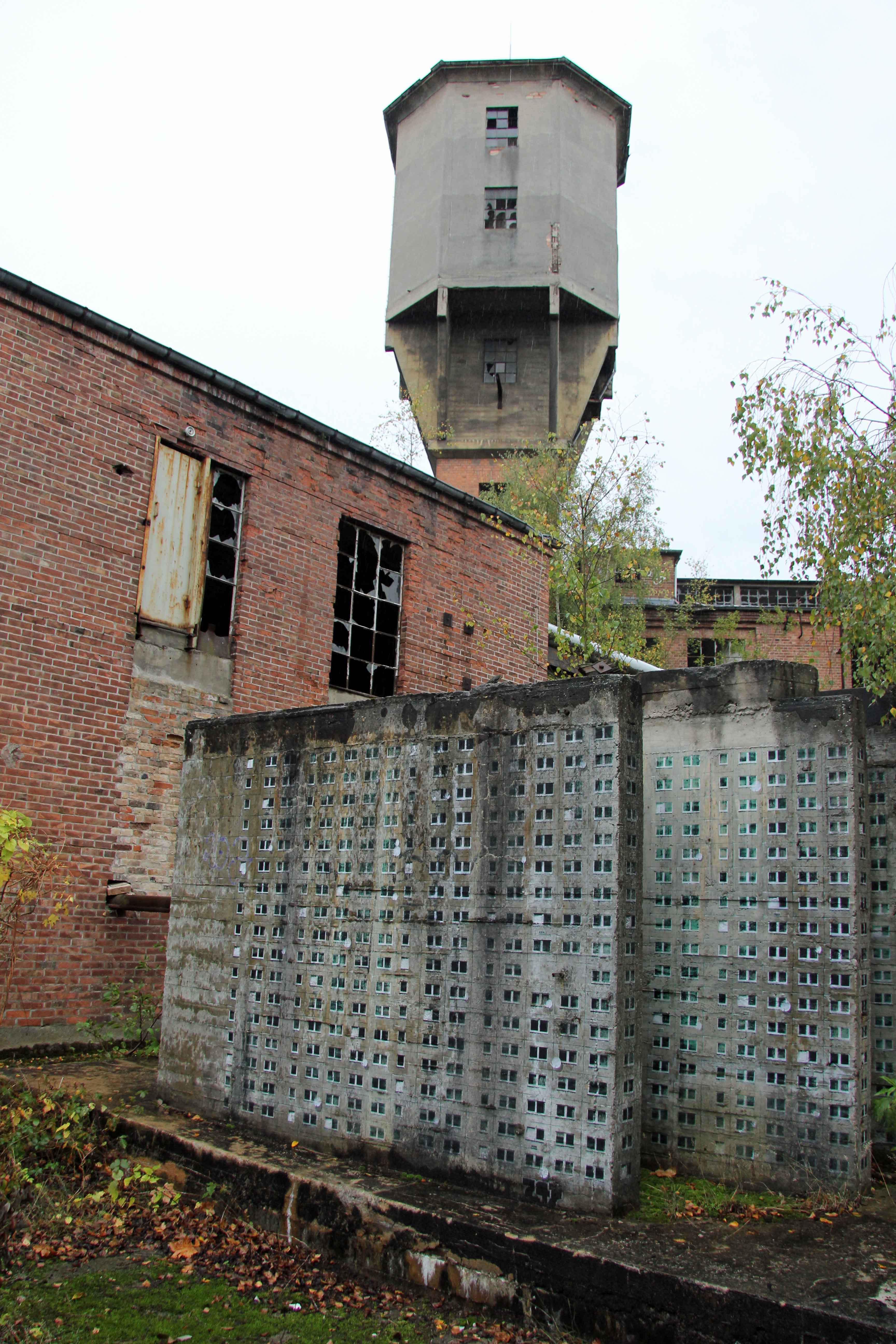 The outside of Papierfabrik Wolfswinkel, an abandoned paper mill near Berlin and artwork by EVOL