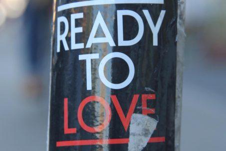 Ready To Love: Sticker on a Berlin post
