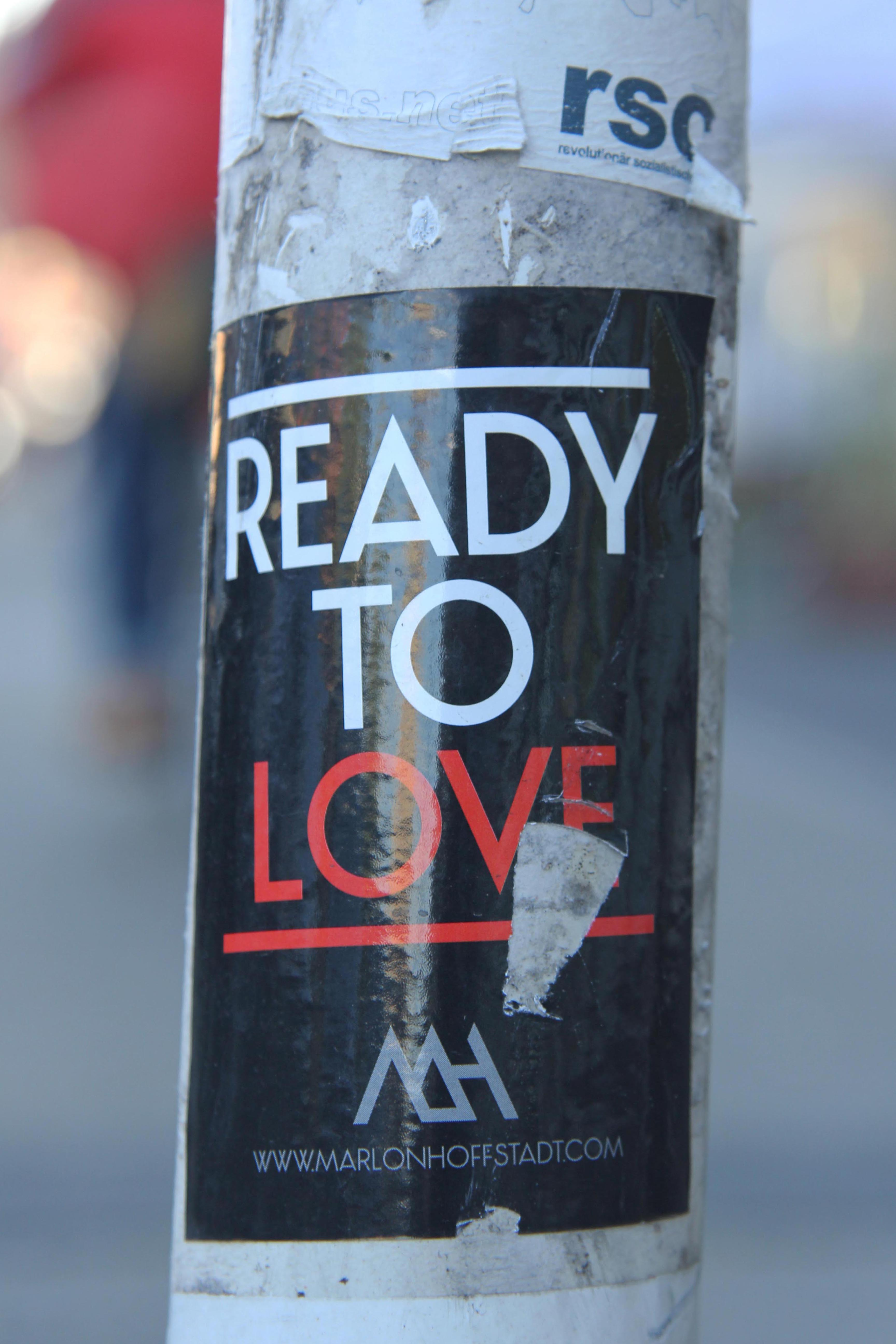 Ready To Love: Sticker on a Berlin post