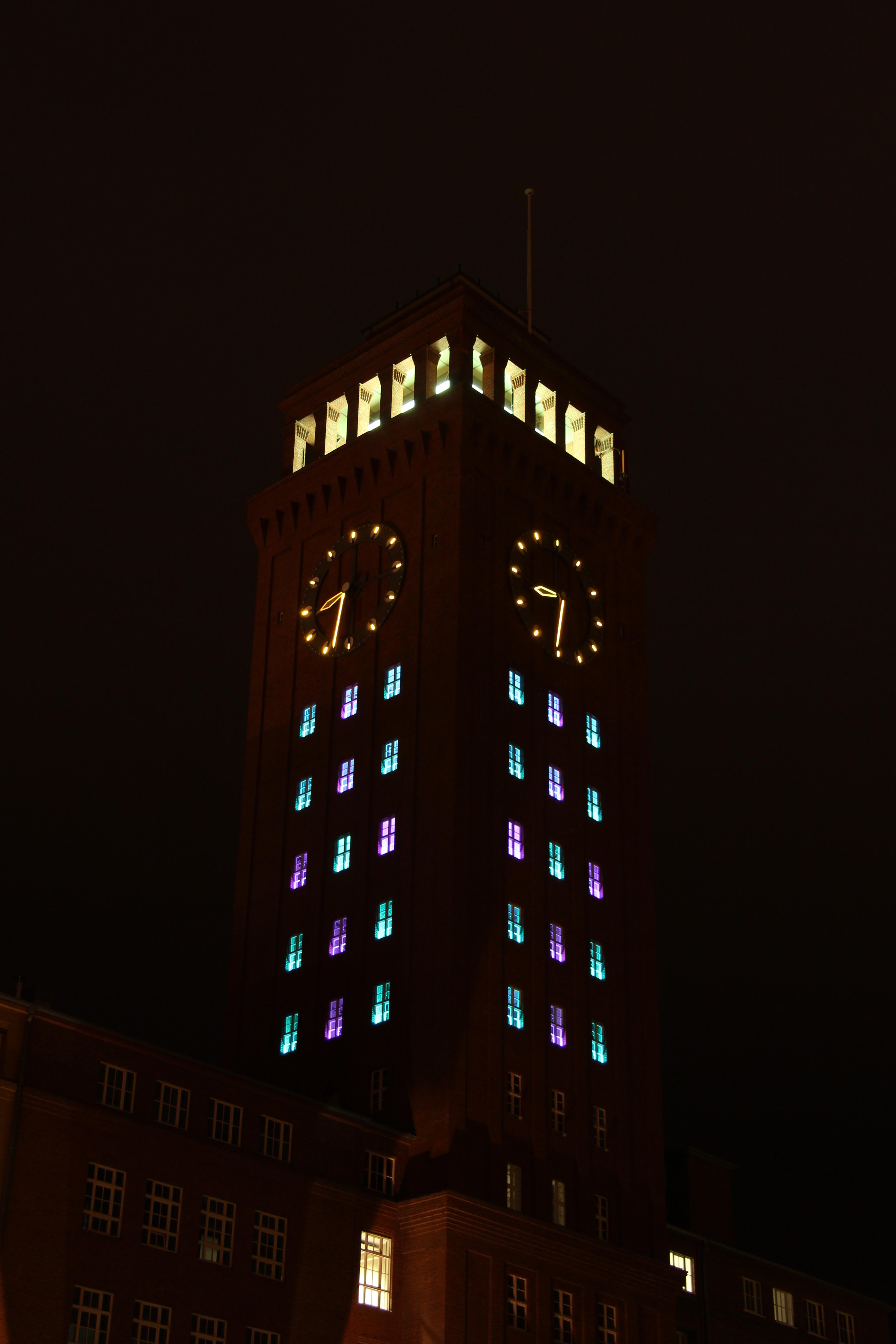A light instillation in the Siemens AG clock tower at Technopark during the Festival of Lights in Berlin