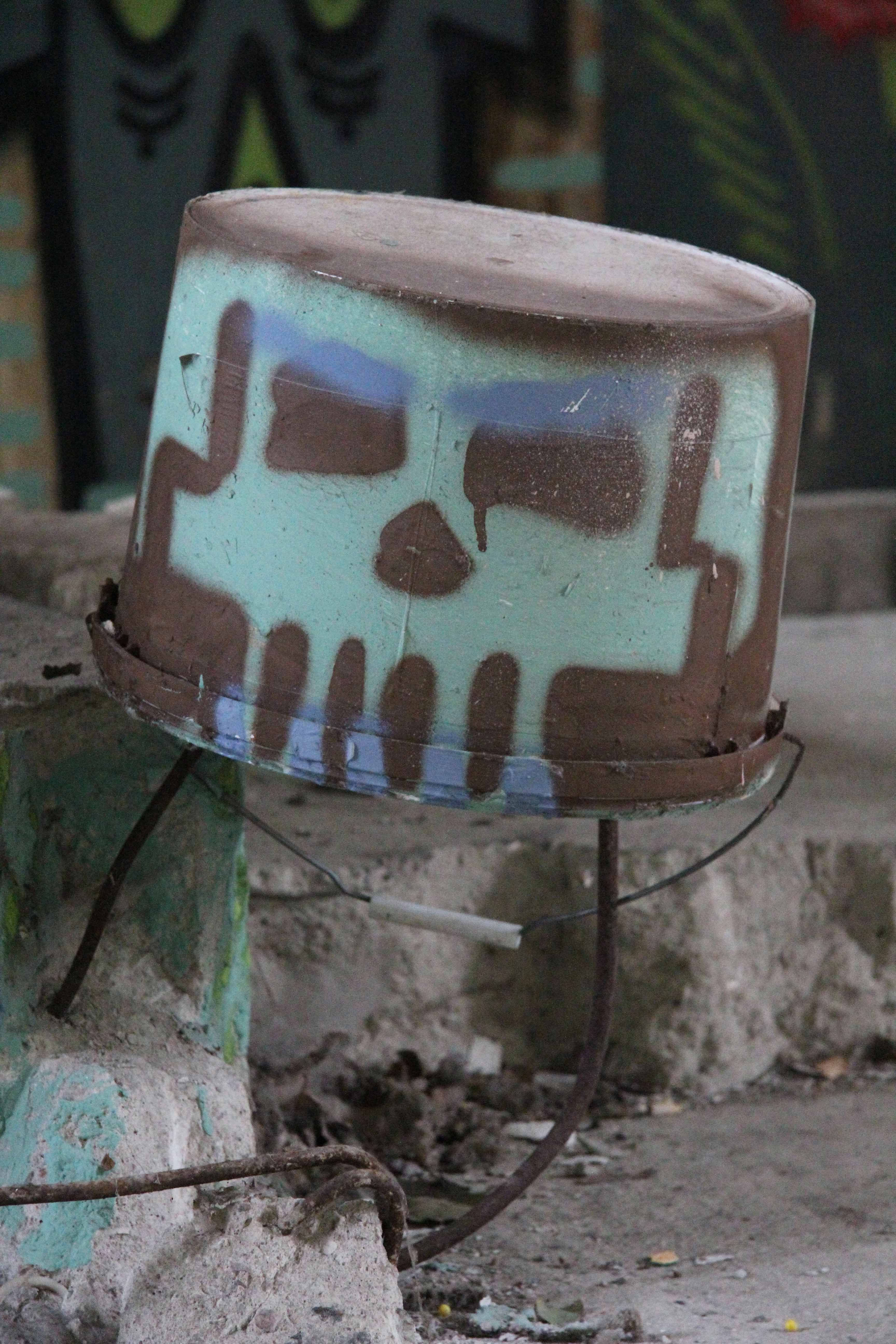Bucket Skull: Street Art by Unknown Artist at Papierfabrik Wolfswinkel near Berlin