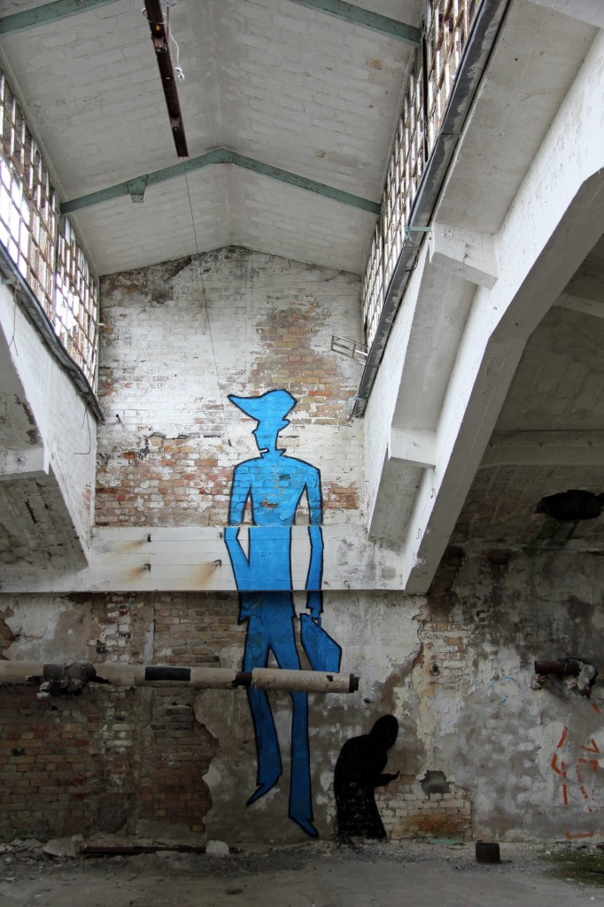 Tall Blue Man: Street Art by Unknown Artist at Papierfabrik Wolfswinkel near Berlin
