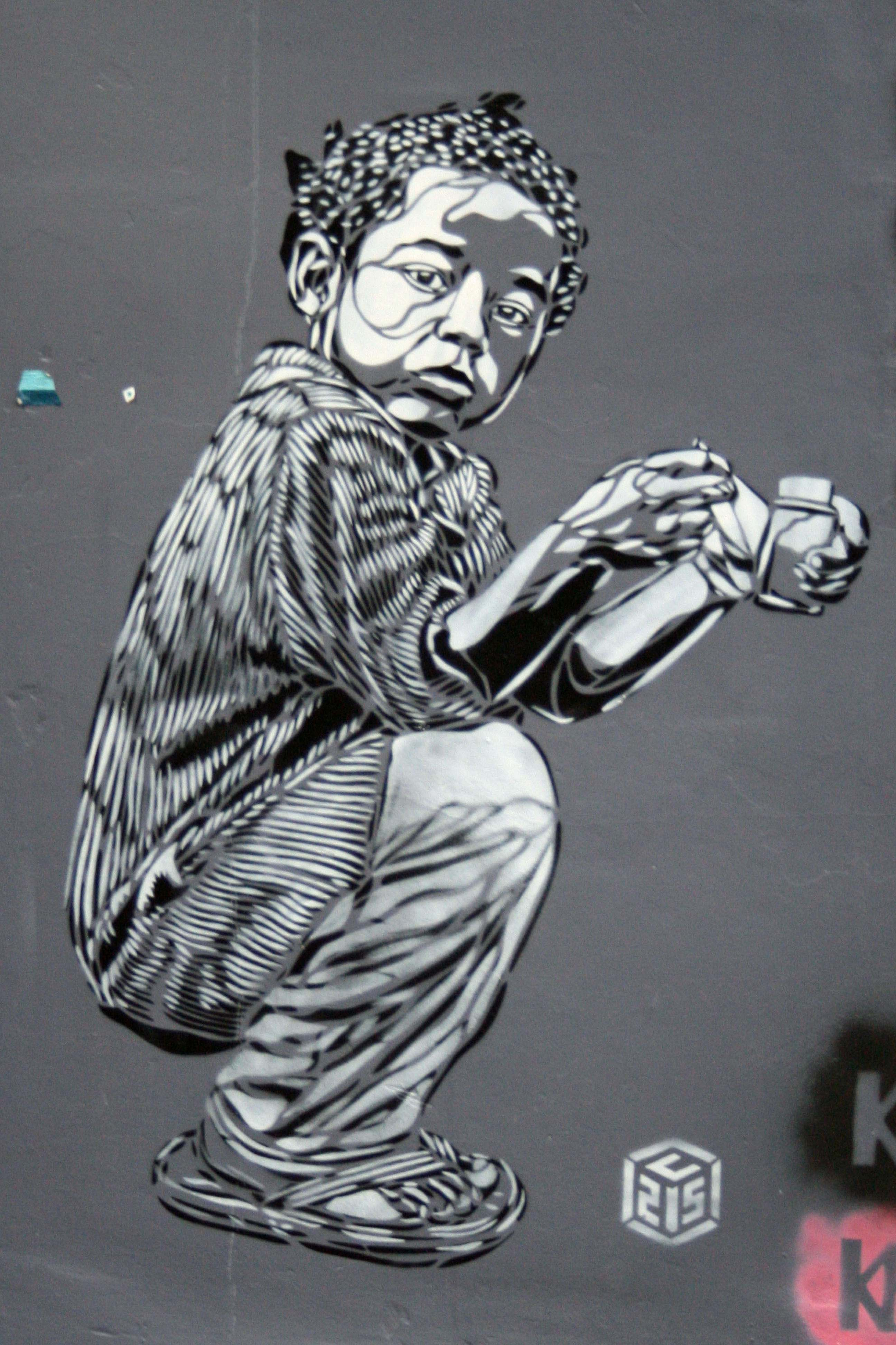 Crouching - Street Art by C215 in Brighton