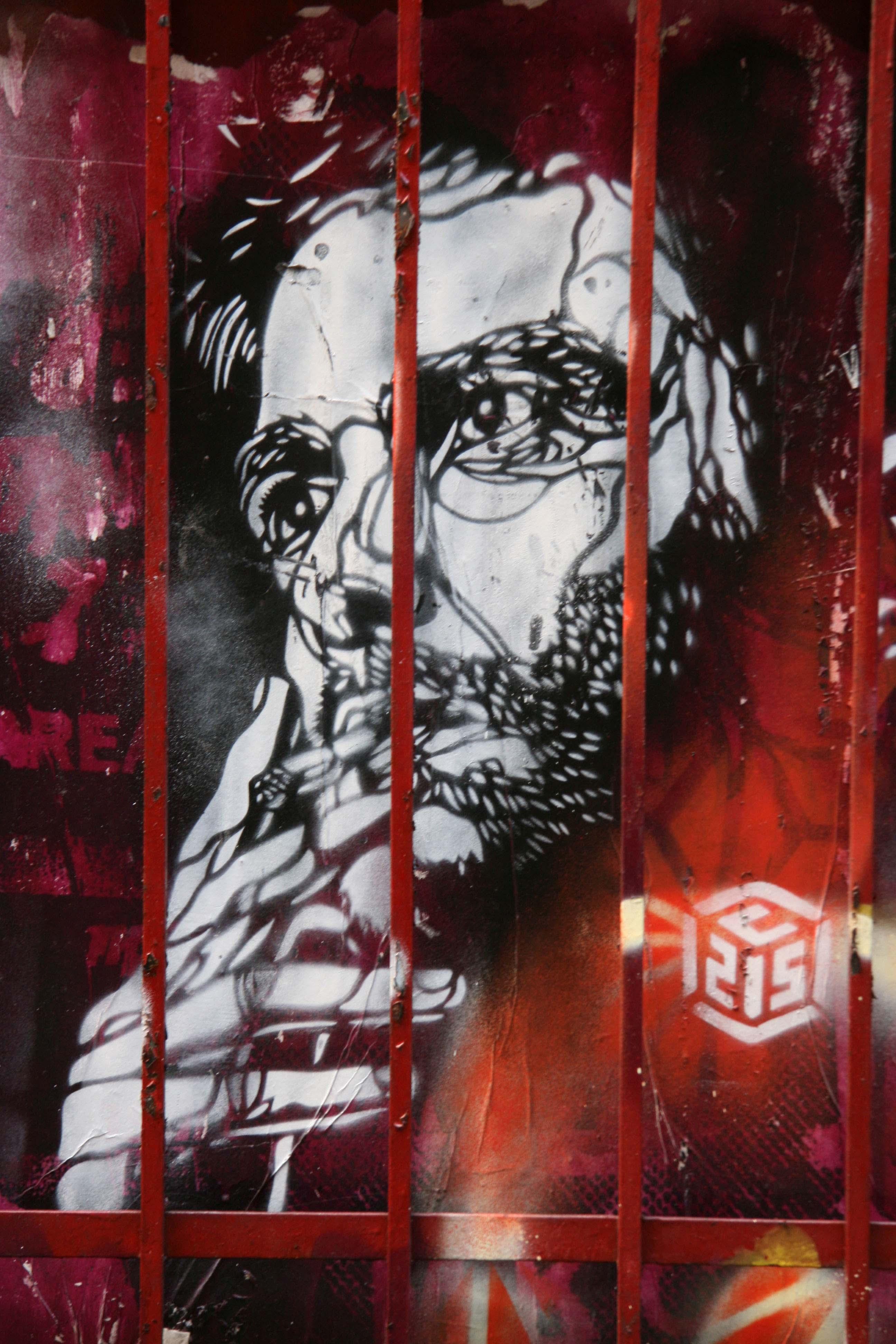 Smoker Behind Bars (London) - Street Art by C215 in London