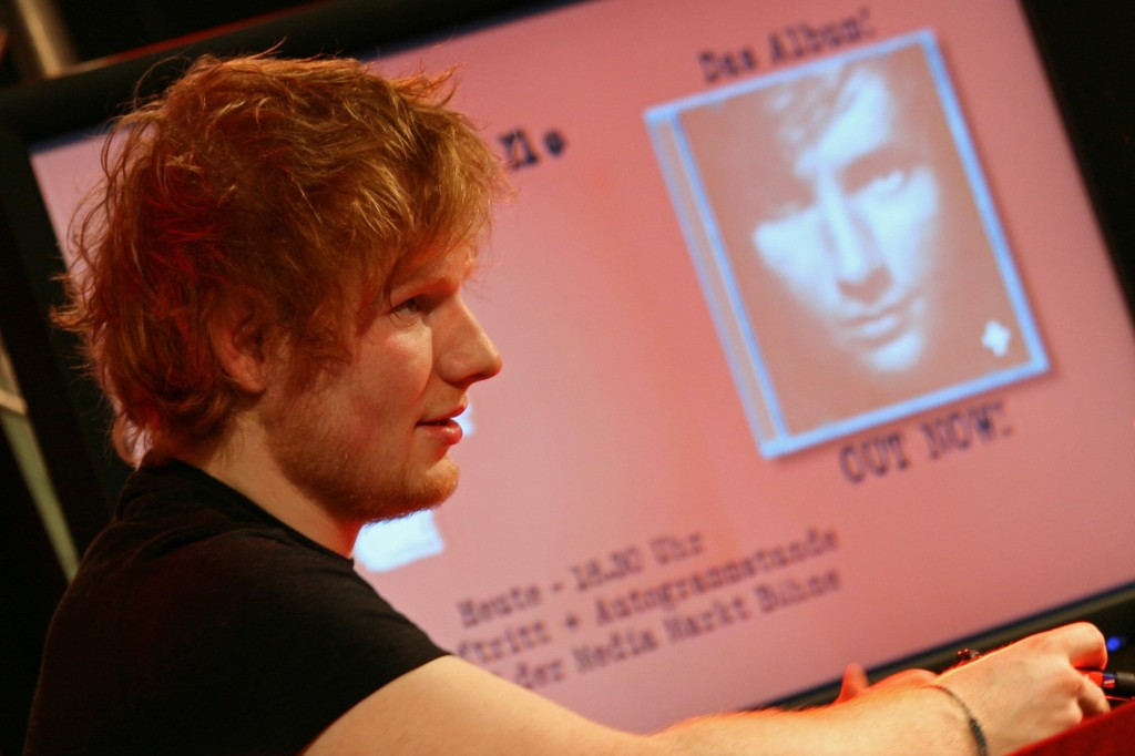 Ed Sheeran signing autographs for fans at Alexa Berlin