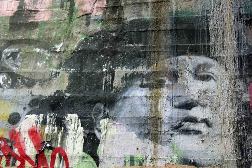 A face at the legal graffiti spraying area in a tunnel at Natur-Park Schöneberger Südgelände in Berlin