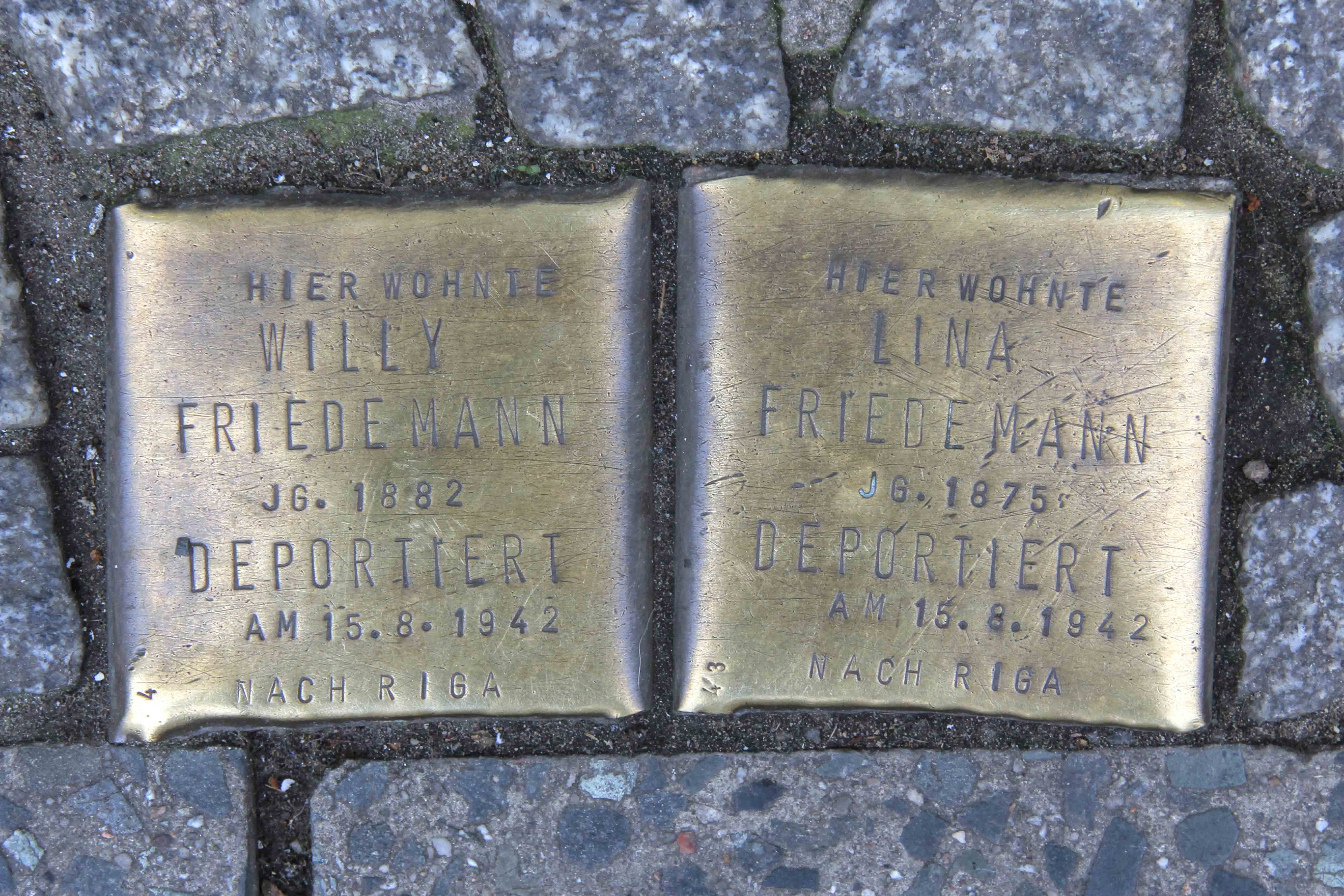 Stolpersteine Berlin 151: In memory of Willy Friedmann and Lina Friedmann (outside Apotheke am Moritzplatz at Oranienstrasse 158)