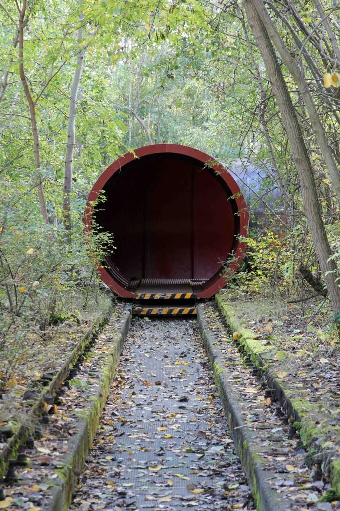 A tunnel and train tracks at Natur-Park Schöneberger Südgelände in Berlin