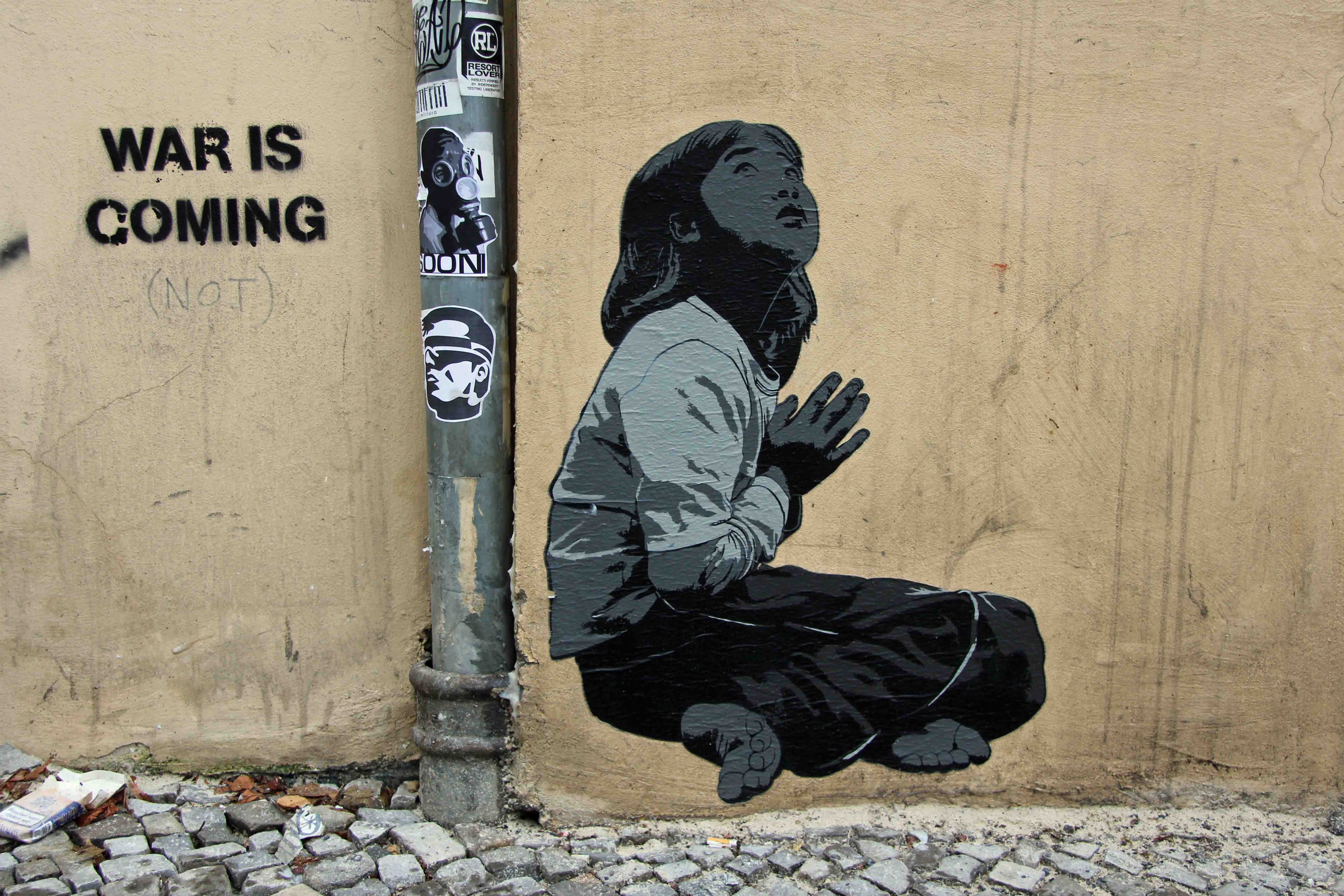 Praying - Street Art by ALIAS in Berlin