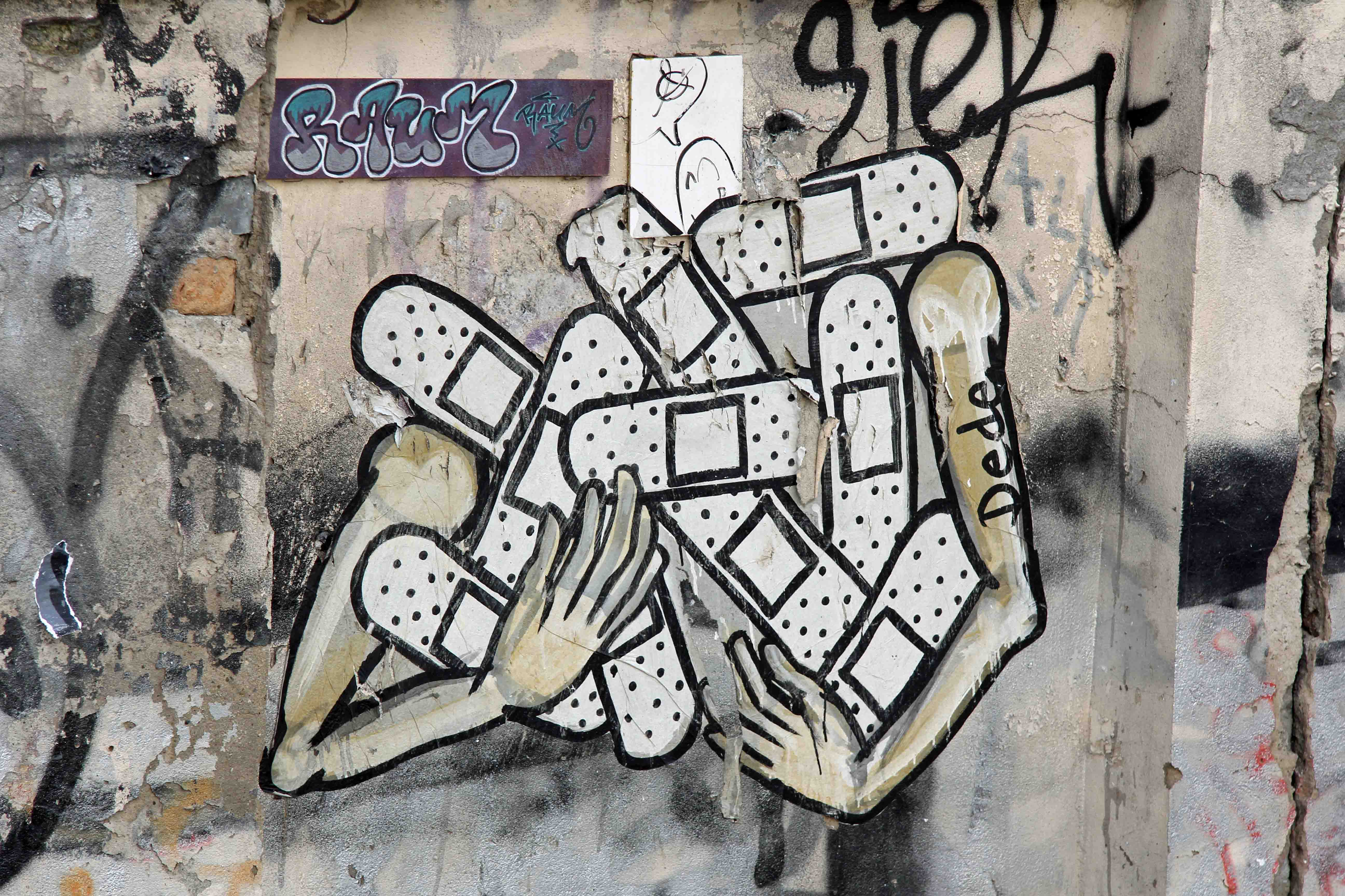 Arms Full of Plasters (Caffeine) - Street Art by Dede in Berlin