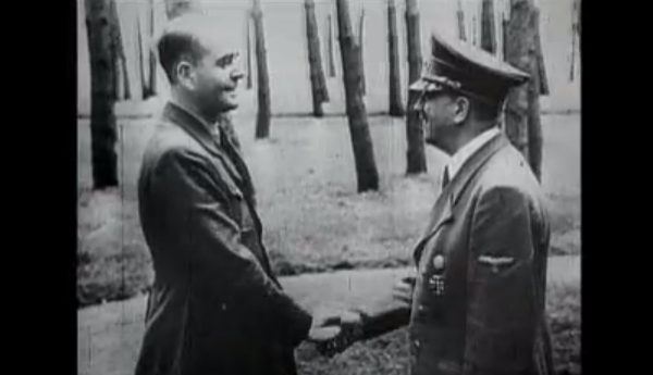 Albert Speer shakes hands with Adolf Hitler in a still from the documentary: Hitler's Henchmen - Speer - The Architect
