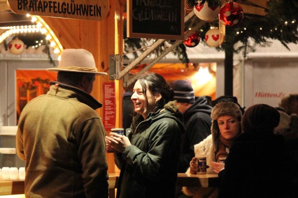 People Drinking Glühwein at Weihnachtsmarkt vor dem Schloss Charlottenburg - a Christmas Market in Berlin