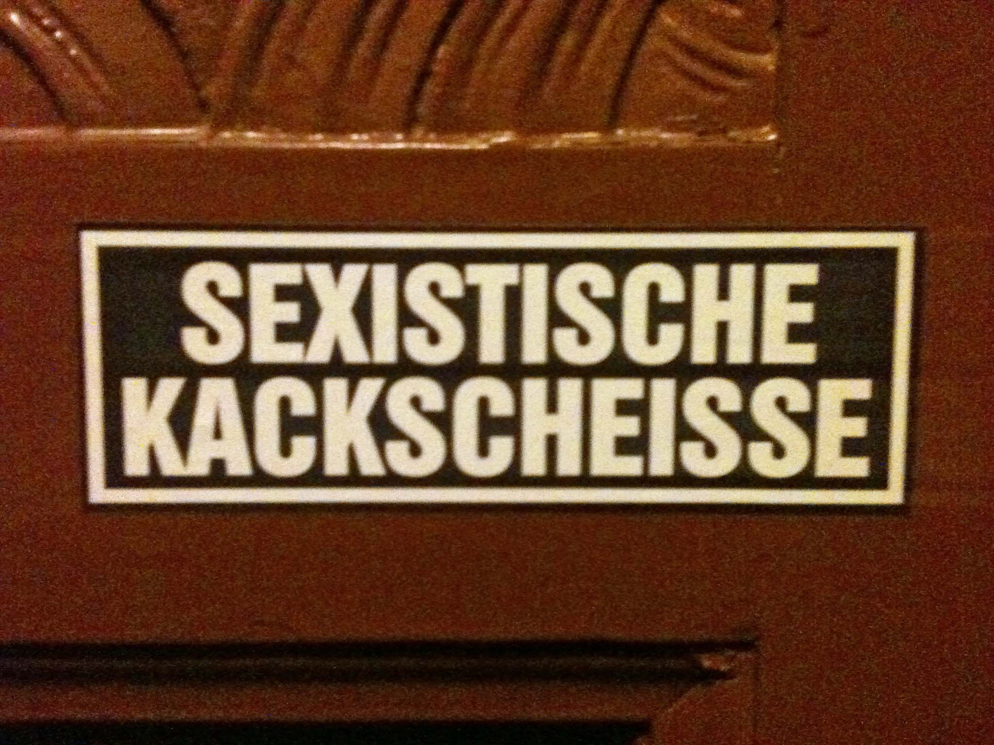 Sexistische Kackscheisse (Sexist Shit Shit) - Sticker in a Berlin apartment building