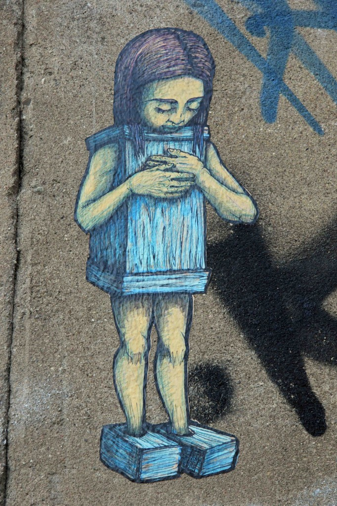 Wooden Girl - Street Art by Unknown Artist in Berlin