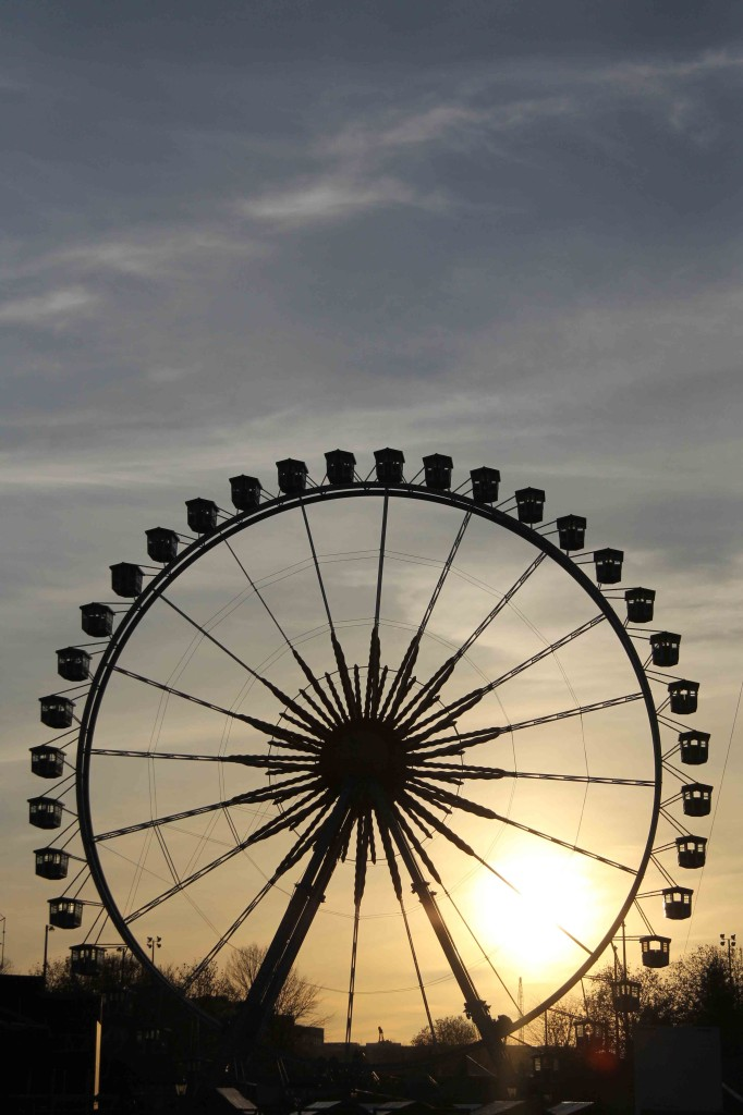 Wheels On Fire - The Sun Through The Ferris Wheel on Alexanderplatz Berlin