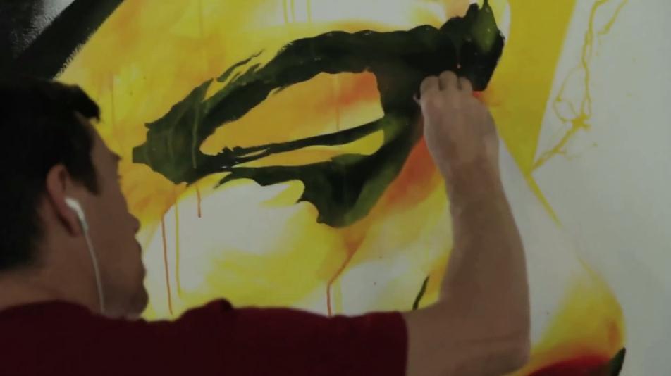 DAN23 painting at Stroke Urban Art Fair Berlin 2012 (screenshot from the official video)