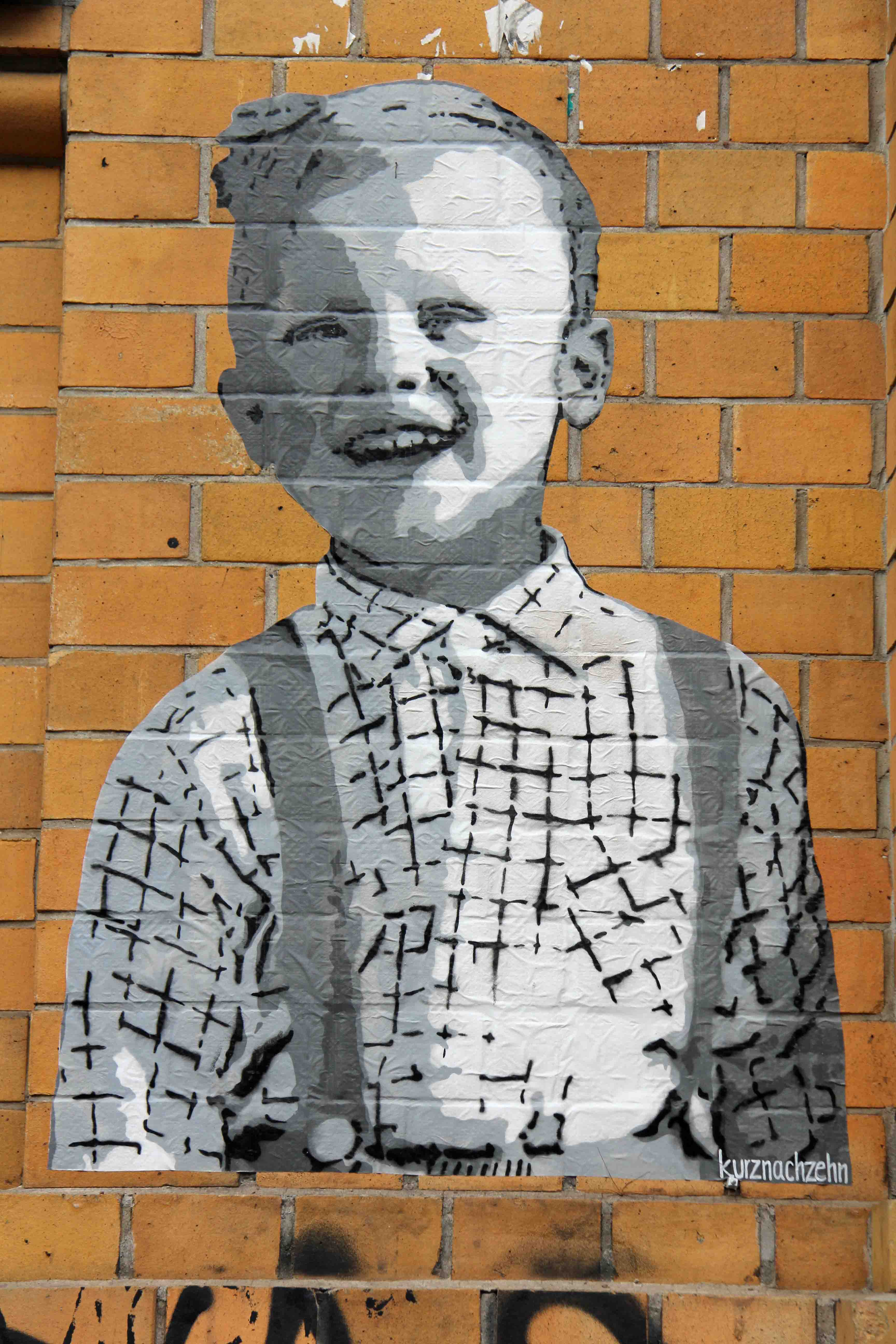 Boy With Braces - Street Art by kurznachzehn in Berlin