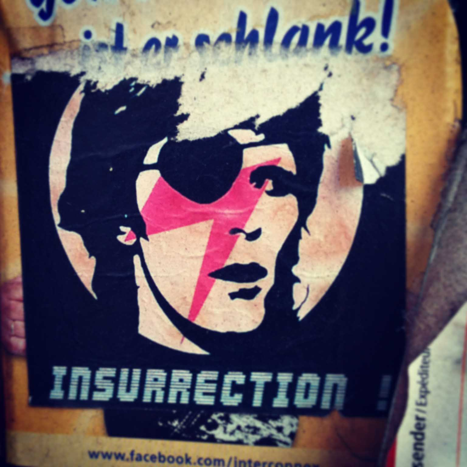 Bowie Insurrection Sticker by Maxx on a Berlin lamp post
