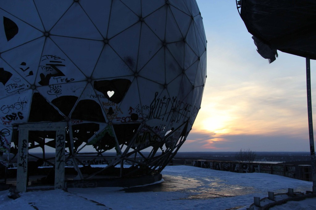 A dome and the setting sun on the roof of the former NSA Listening Station at Teufelsberg in Berlin