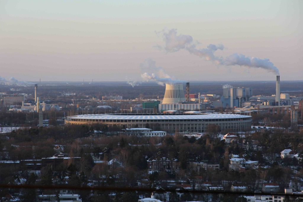 Olympiastadion (the Olympic Stadium) and a factory from the former NSA Listening Station at Teufelsberg in Berlin