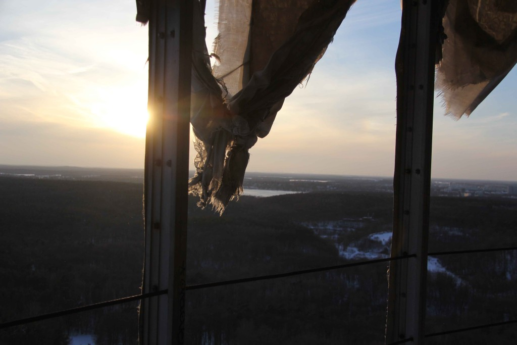 Tattered sheeting and the Wannsee from the highest tower of the former NSA Listening Station at Teufelsberg in Berlin