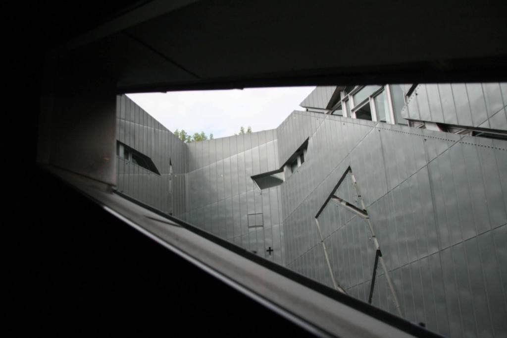 A view out of an opening in The Libeskind Building of the Jewish Museum Berlin