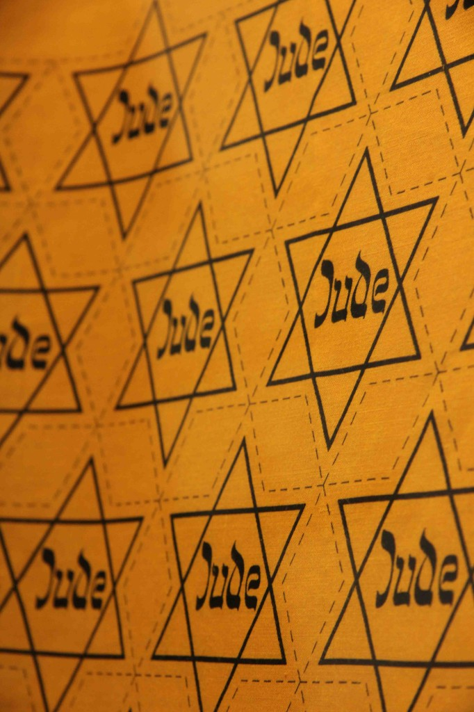 Yellow fabric with Jewish Stars by Geitel & Co at Jewish Museum Berlin