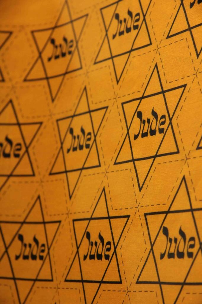 Yellow fabric with Jewish Stars by Geitel & Co at Jewish Museum Berlin