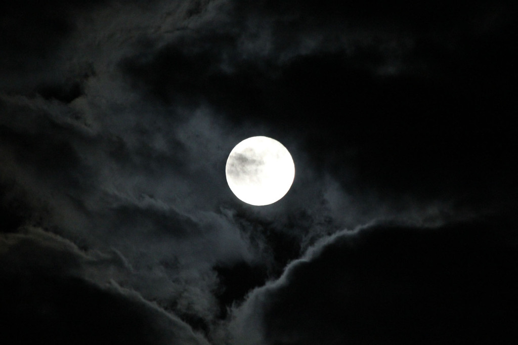 Full Moon over Berlin in a cloudy sky