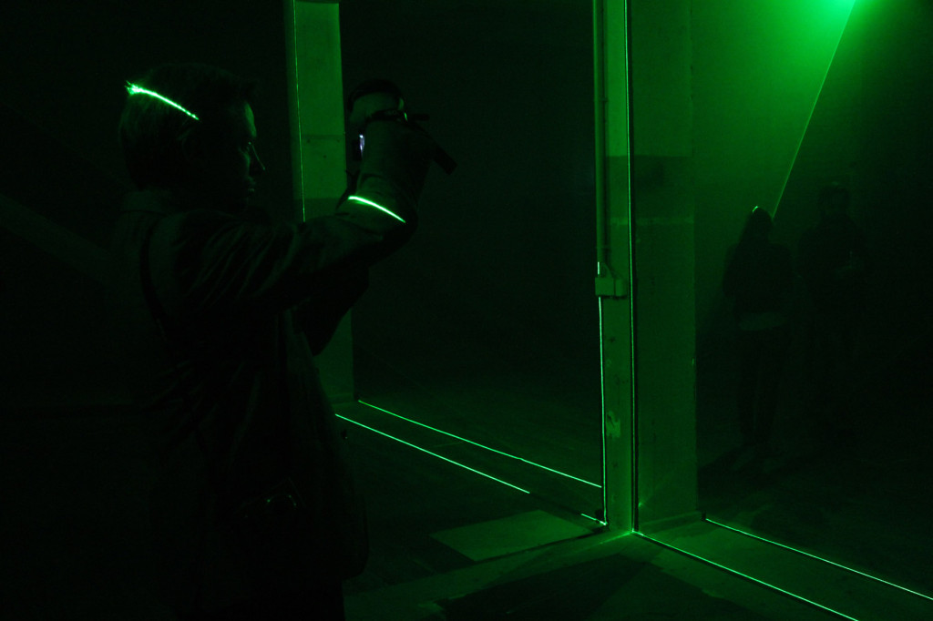 A visitor taking photographs in Shan Blume's OT_L_Space_01 at the Olympus OM-D Photography Playground the Opernwerstätten in Berlin