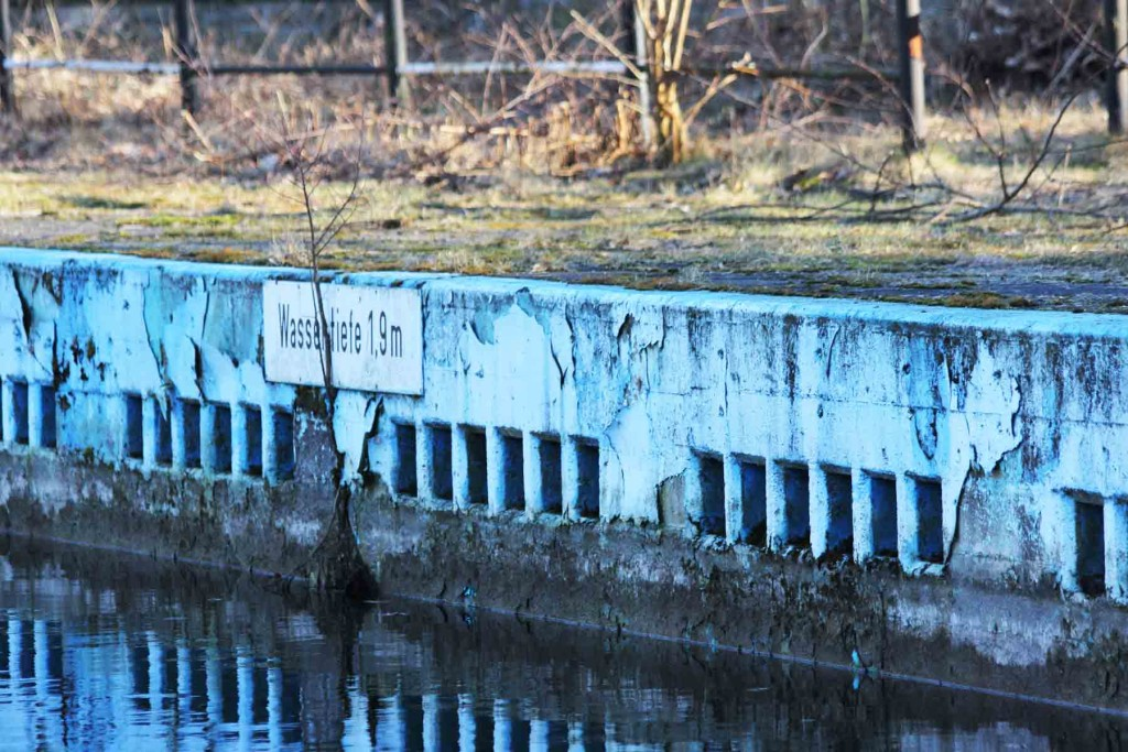 Wassertiefe sign at the abandoned swimming pool Wernerbad (Freibad Wernersee) in Kaulsdorf, Berlin