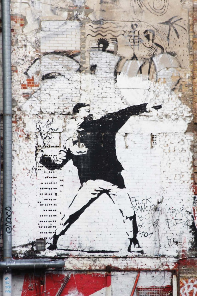 Flower Chucker / Thrower - Street Art by Banksy in the courtyard of the Kunsthaus Tacheles Berlin