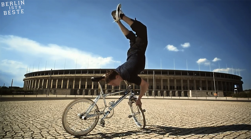 Frank Wolf on a BMX outside the Olympic Stadium - Screenshot from Die Berlin Hymne - Berlin ist Beste