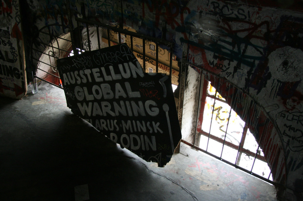 Global Warming Exhibition sign inside the former artists squat Kunsthaus Tacheles in Berlin