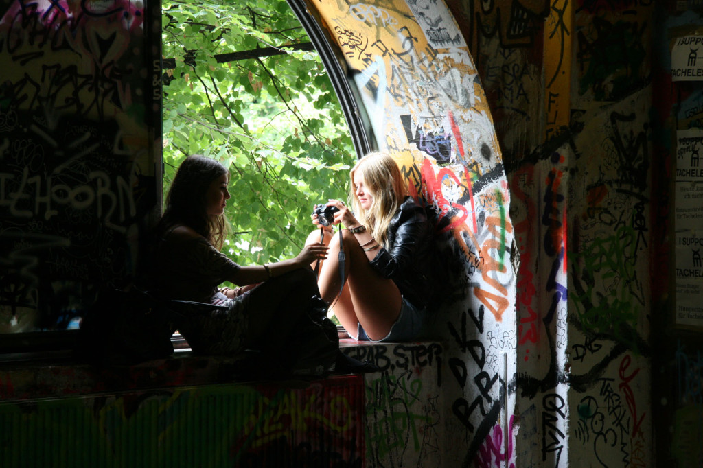 Tourists relaxing inside the former artists squat Kunsthaus Tacheles in Berlin
