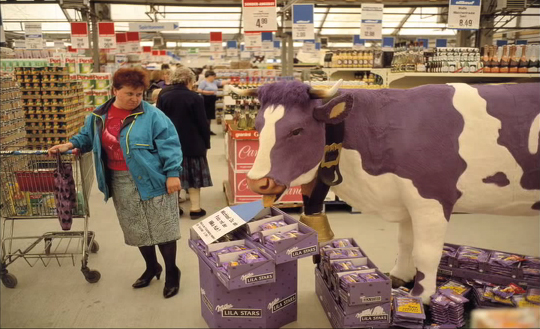 East German lady and Milka Cow - Thomas Hoepker for Magnum