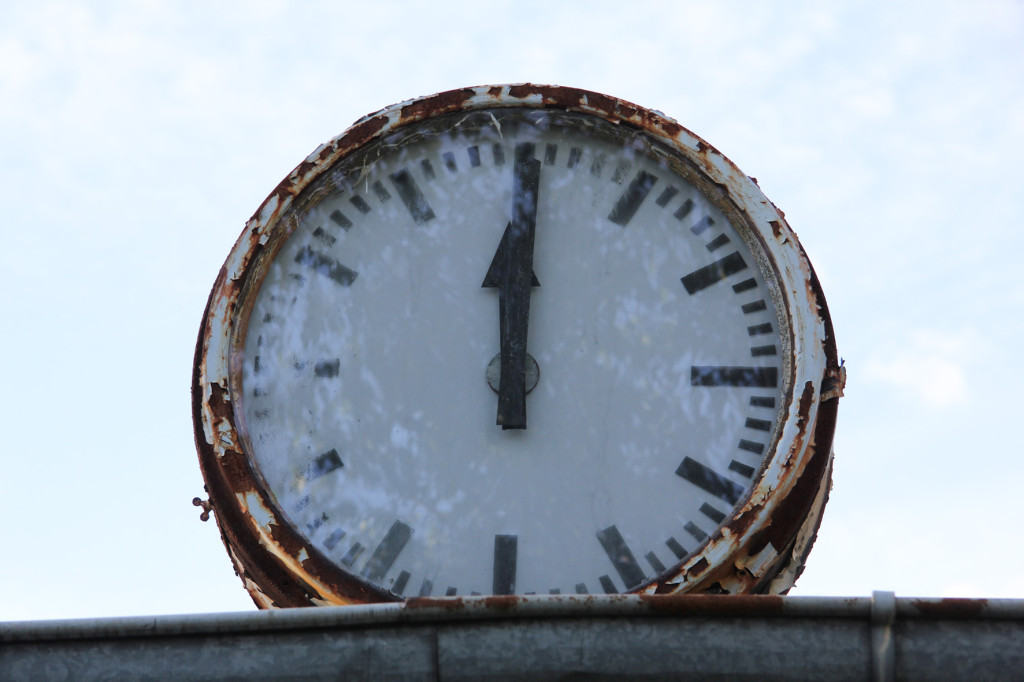 Rusted Clock on Changing Rooms at BVG Freibad (also BVB Freibad) an abandoned swimming pool on Siegfriedstrasse in Berlin Lichtenberg
